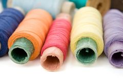 Multicolor thread reels on white Stock Images