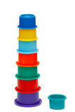 Multicolor tower of cups. And one cup of different color Royalty Free Stock Photos