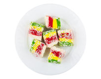 Multicolor Turkish delight in glass plate isolated on white back Royalty Free Stock Photo