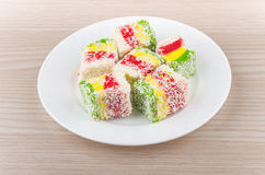 Multicolor Turkish delight in glass plate on table Stock Image