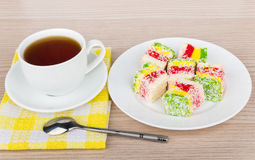 Multicolor Turkish delight in plate and cup of tea Royalty Free Stock Photography