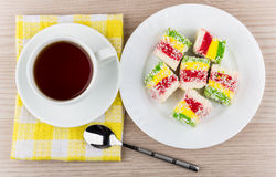 Multicolor Turkish delight in plate and cup of tea Stock Photography