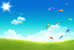 Multicolor umbrella floating in the sky Stock Images
