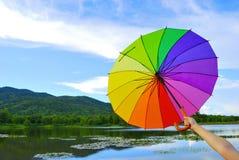 Multicolor umbrella mountain and blue sky Stock Photo