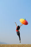 Multicolor umbrella woman and blue sky Stock Photo