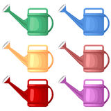 Multicolor watering can Royalty Free Stock Photo