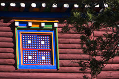 Multicolor window of Tibet. Window and wooden frame, colorful patterns, typical of the Kham region of Tibet Stock Images