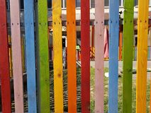 Multicolor wooden fence rainbow painted. Plank red yellow blue green Royalty Free Stock Photos