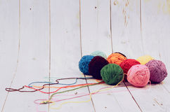 Multicolor wool, balls of wool on wood background. Concept and Decorative wool yarn balls stock image