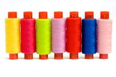 Multicolor yarn bobbins Stock Images