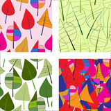 Multicolored abstract seamless patterns with leafs Stock Images