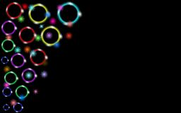 Multicolored abstract shiny beautiful colored neon glowing circles, bubbles, rings with glare of light and bright stars on a black Royalty Free Stock Photo