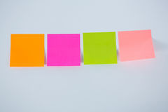 Multicolored adhesive note on white background Stock Photos