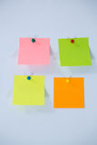 Multicolored adhesive note on white background Royalty Free Stock Images