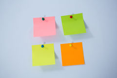 Multicolored adhesive note on white background Stock Photography