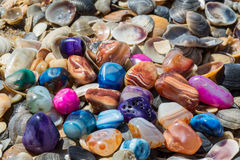 Multicolored agates on the beach Royalty Free Stock Photography