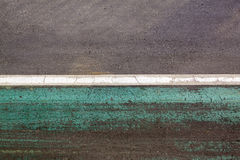 Multicolored asphalt background with white and green stripes Stock Photo