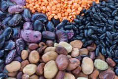 Multicolored background of healthy organic vegan grain food cereal bean lentils ingredients mix. Multicolored background of healthy organic vegetarian grain food stock photography