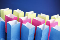 Multicolored bags on blue Stock Photography