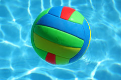 Multicolored ball in the pool. Sport in summer time Stock Photography