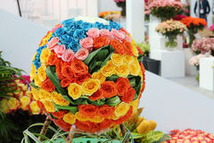 Multicolored ball shaped bouquet of roses in hall Royalty Free Stock Photo