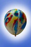 Multicolored balloon. Multicolored balloon on blue background Royalty Free Stock Photos
