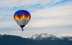Multicolored Balloon in the blue sky Royalty Free Stock Photography