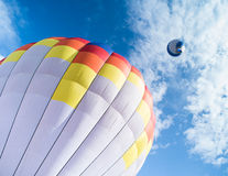 Multicolored Balloon in the blue sky Royalty Free Stock Photos