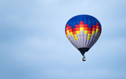 Multicolored Balloon in the blue sky Royalty Free Stock Image