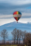 Multicolored Balloon in the blue sky Stock Photography