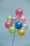 Multicolored balloons. On blue sky stock photo