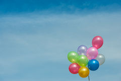 Multicolored balloons. On blue sky royalty free stock photos