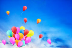 Multicolored balloons in the city festival. Multicolored balloons in the city festival, concept of happy birthday in summer and wedding honeymoon party Royalty Free Stock Photography