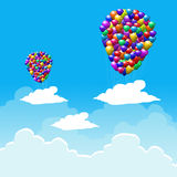 Multicolored balloons with cloudy sky Royalty Free Stock Photos