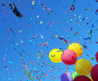 Multicolored balloons and confetti on blue sky Royalty Free Stock Image