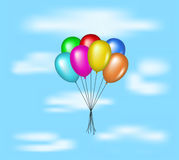 Multicolored balloons flying on blue sky Stock Image