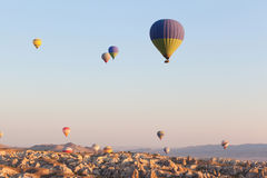 Multicolored balloons in flying in sky, sunrise time Royalty Free Stock Photos