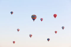 Multicolored balloons in flying in sky, sunrise time Royalty Free Stock Images
