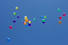 Multicolored balloons flying up in the sky Stock Image