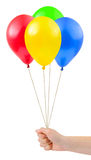 Multicolored balloons in hand Stock Photo