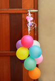 Multicolored balloons hanging on door Stock Photography