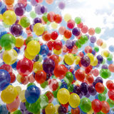 Multicolored balloons in sky Stock Image