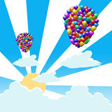 Multicolored balloons with sunrise Stock Images