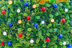 Multicolored balls on the Christmas tree Royalty Free Stock Photography