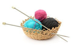 Multicolored balls and needles in basket Stock Photos