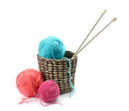 Multicolored balls and needles in basket Stock Photography
