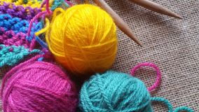 Multicolored balls of yarn for knitting and crochet. On jute background Royalty Free Stock Photo