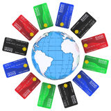 Multicolored bank cards around the Earth Royalty Free Stock Photography