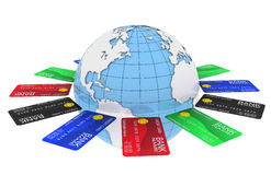 Multicolored bank cards around the Earth Stock Photo