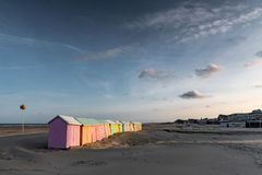 Colorful beach bathing cabins. Multicolored bathing wooden huts lined up on the deserted beach of Berck-sur-Mer, France, in the early morning Stock Photography